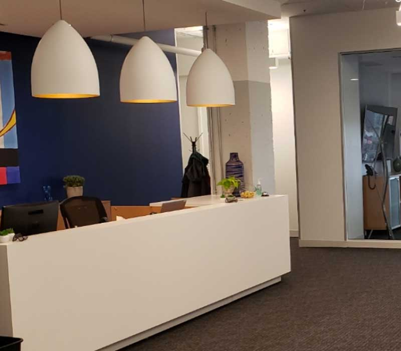 sra law office front desk with three white lights hanging above